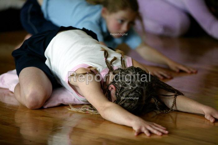 Pupils exercising in a before school morning Yoga class, Mytham CP School, Bolton. - John Harris - 2005-06-14