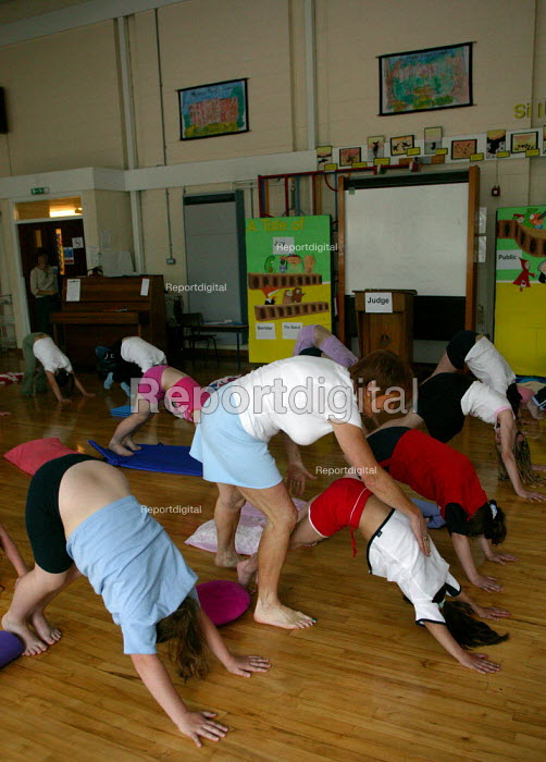 Alwynne Cartmell teaching yoga. Pupils exercising in a pre school morning Yoga class, Mytham CP School, Bolton. - John Harris - 2005-06-14