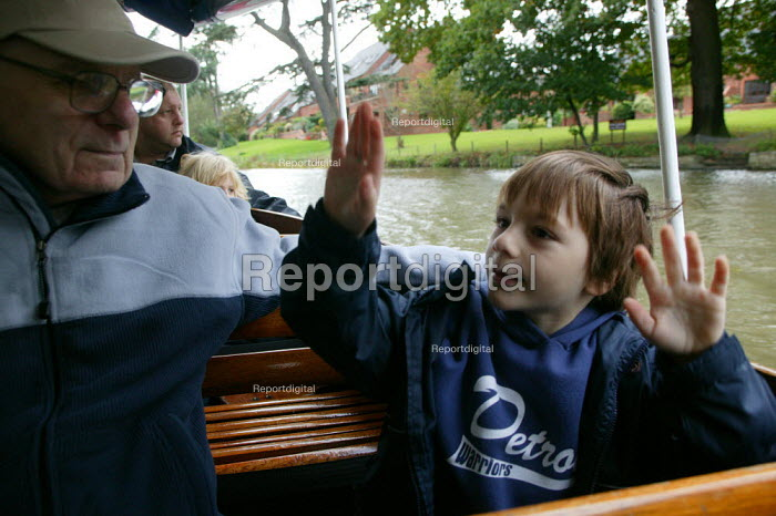 Grandfather and grandson on a river trip, Stratford upon Avon. - John Harris - 2005-10-29