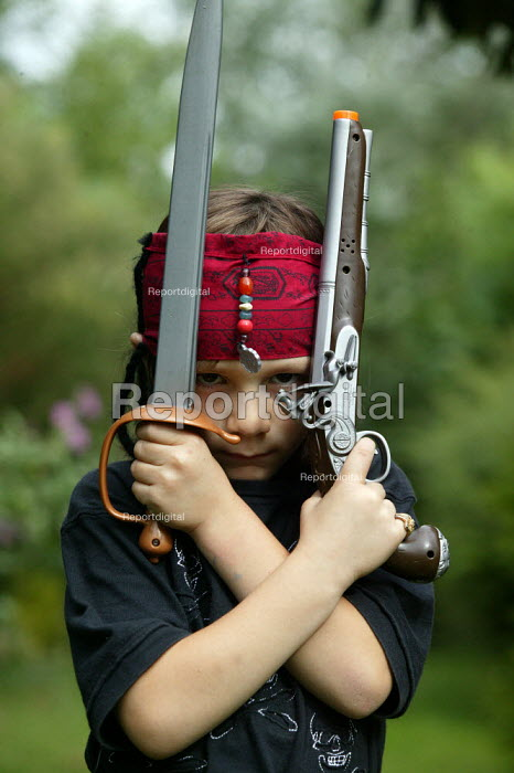 Small boy dressed up as Captain Jack Sparrow, pirate from the film Pirates of the Caribbean. - John Harris - 2006-07-01