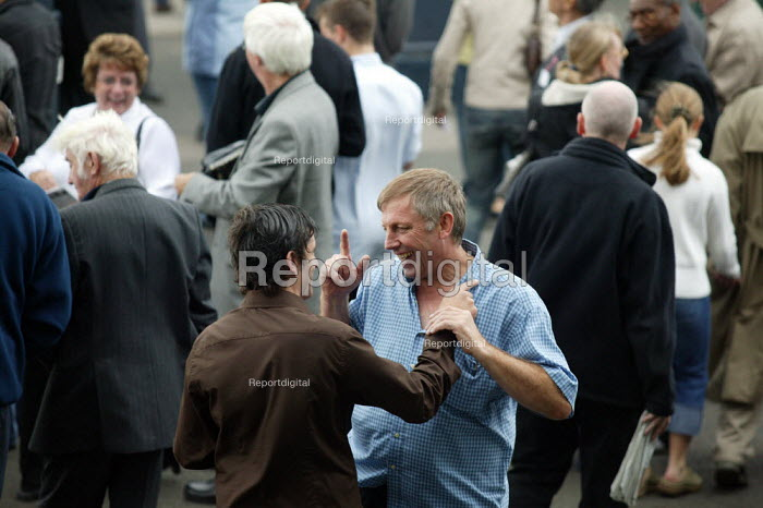 Punters celebrate winning. Steeplechase racing at Stratford on Avon racecourse. - John Harris - 2006-09-02
