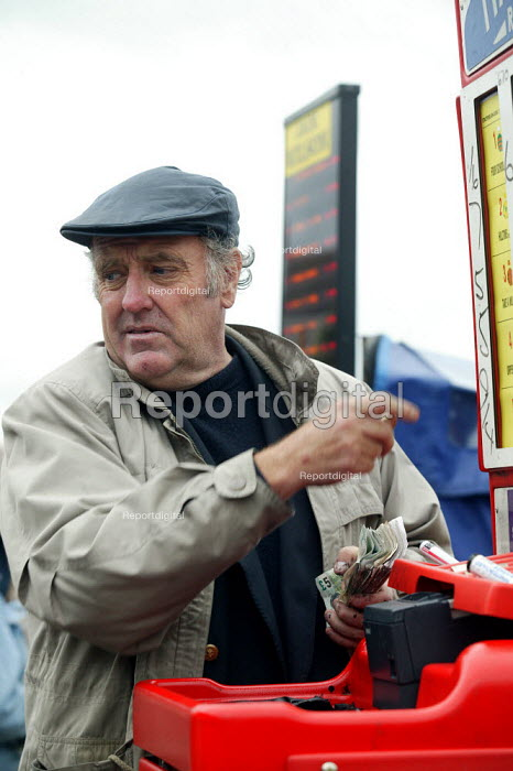 Bookmakers taking bets. Steeplechase racing at Stratford on Avon racecourse. - John Harris - 2006-09-02