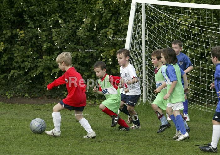 Primary school pupils playing football. - John Harris - 2006-10-18