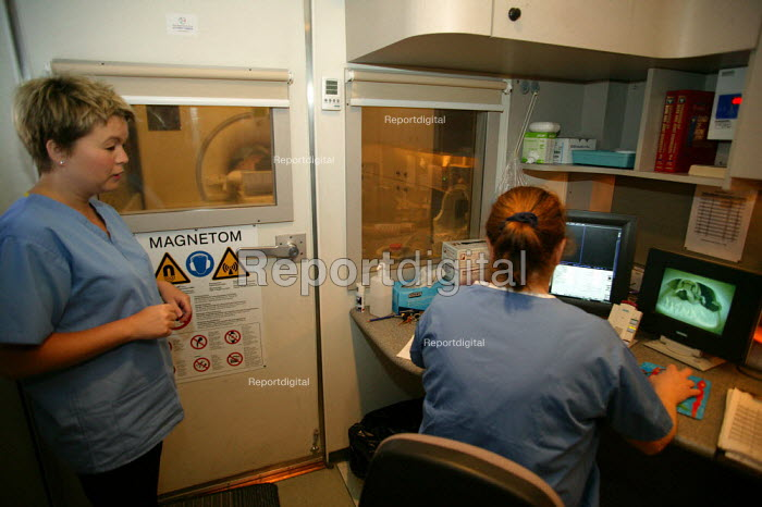 Patient and radiographer at a mobile MRI, magnetic resonance imaging scanner Warwick Hospital. - John Harris - 2007-03-19