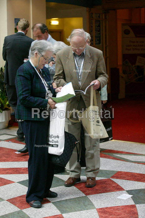 Elderly delegates looking at the agenda Conservative Party Conference Blackpool - John Harris - 2007-10-02
