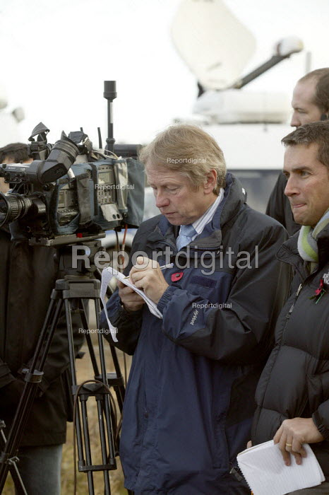 Sky TV journalist making notes at press conference about the search for the firefighters who died in the fire at the Atherstone warehouse. Four firefighters are believed to have died tackling the blaze. Packhouse at Bomfords Ltd Atherstone Industrial Estate, Stratford upon Avon. - John Harris - 2007-11-06