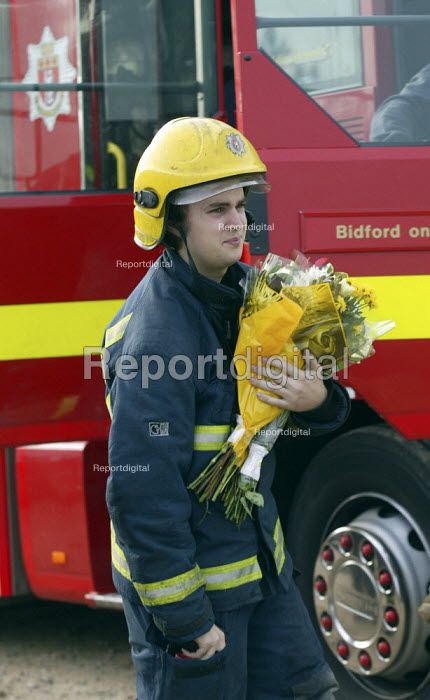 Firefighters from Bidford on Avon leaving flowers in memory of the firefighters who died in the fire at the Atherstone warehouse. Four firefighters are believed to have died tackling the blaze. Packhouse at Bomfords Ltd Atherstone Industrial Estate, Stratford upon Avon. - John Harris - 2007-11-05