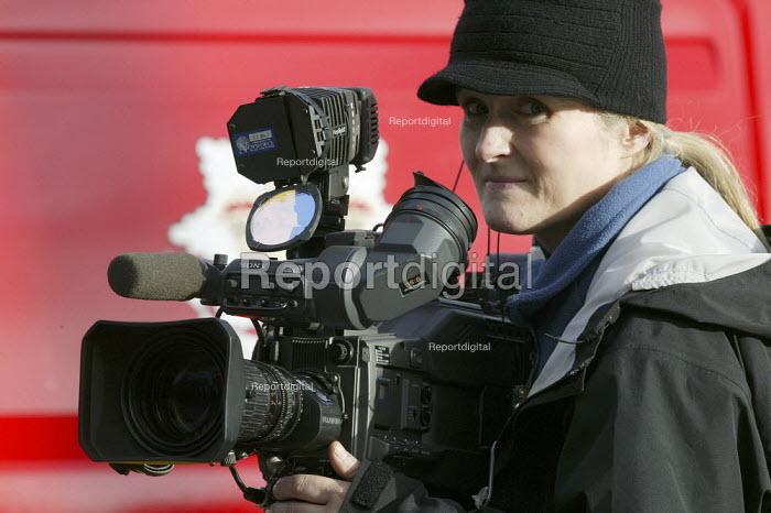 Woman camera operative filming a news story - John Harris - 2008-01-25