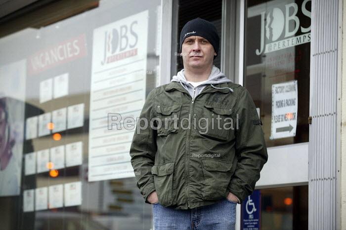 Worker outside a job agency in West Bromwich. - John Harris - 2008-02-20