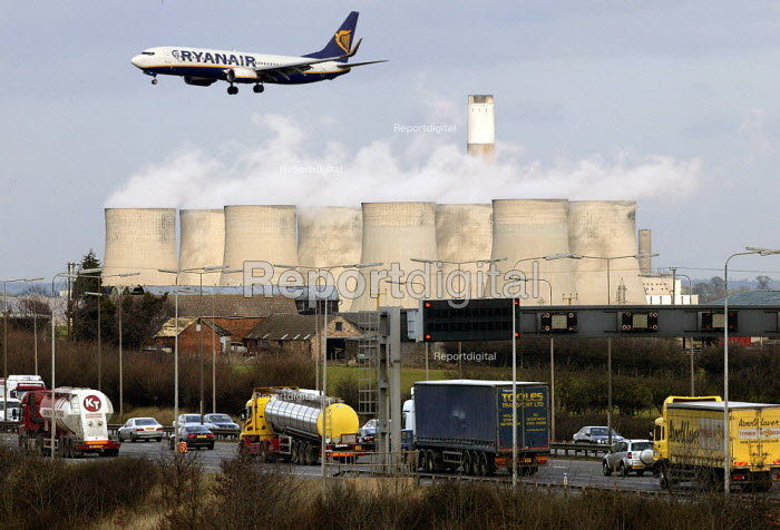 A Ryanair passenger jet coming into land at East Midlands Airport over the M1 Motorway and Ratcliffe-on-Soar power station. Nottinghamshire - John Harris - 2008-02-27