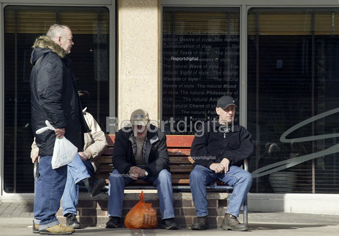 Unemployed men sitting in the city square. Derby - John Harris - 2008-02-27
