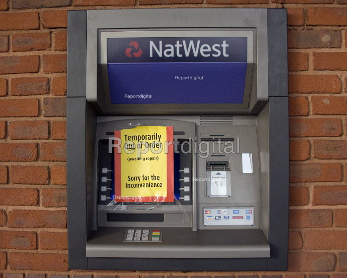 Thousands of pounds were stolen from 24 hour cash machines by thieves from a supermarket in a night time raid. - John Harris - 2008-02-22