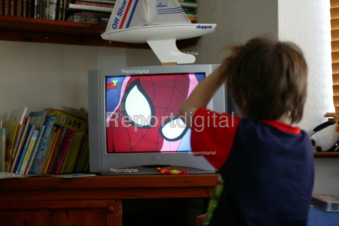 Young boy watching Spider man on television at home - John Harris - 2004-07-25