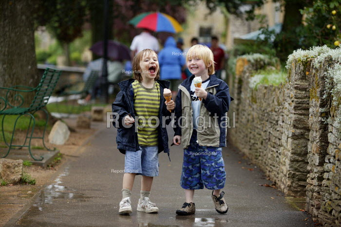 Boys enjoying ice cream, Bourton on the Water. - John Harris - 2004-08-16