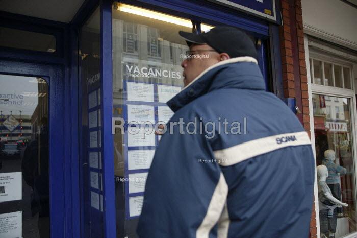 Looking for work in the window of a job agency in West Bromwich. - John Harris - 2008-02-20