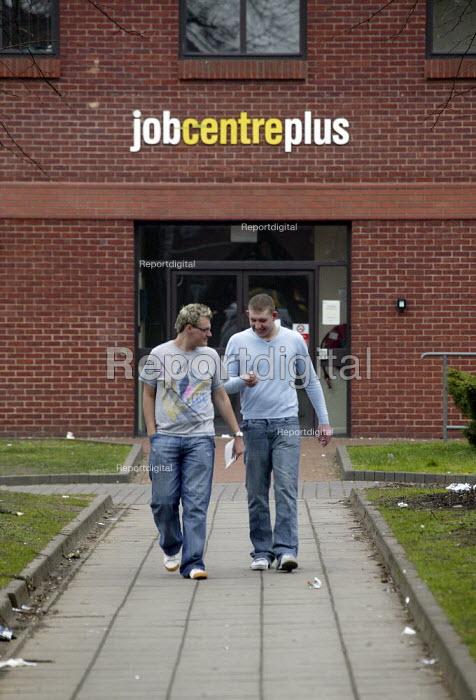 Young men leaving Jobcentre Plus in West Bromwich. - John Harris - 2008-02-20