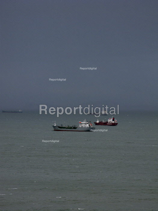 Tankers at anchor, waiting to enter Milford Haven and oil terminal, Pembroke port St Brides Bay, off the coast of Pembrokeshire - John Harris - 2008-02-05