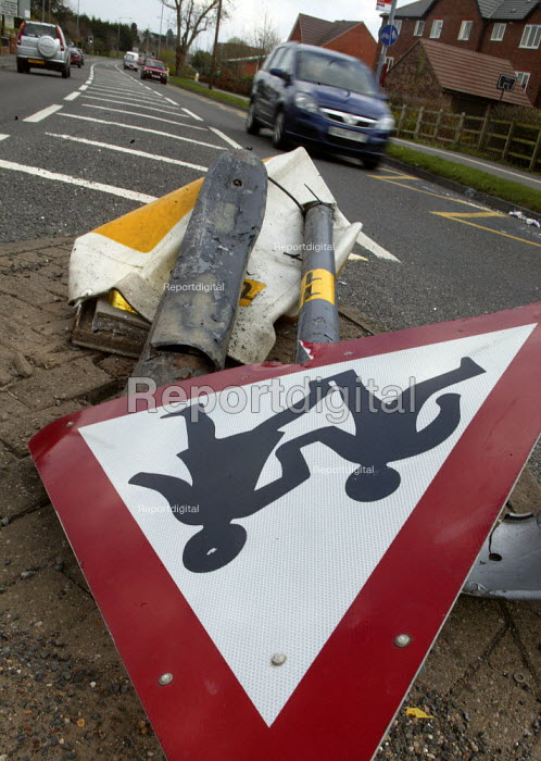 A sign warning of children crossing the road which has been knocked down in a road traffic accident. - John Harris - 2008-04-04