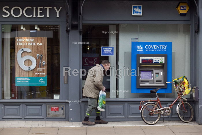 An elderly man at a building society branch in the High Street. - John Harris - 2008-04-25