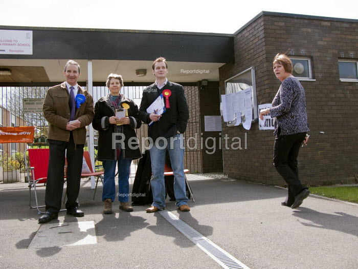 Conservative. Liberal Democrat and Labour Party candidates outside a polling station. Stratford upon Avon. - John Harris - 2008-05-01