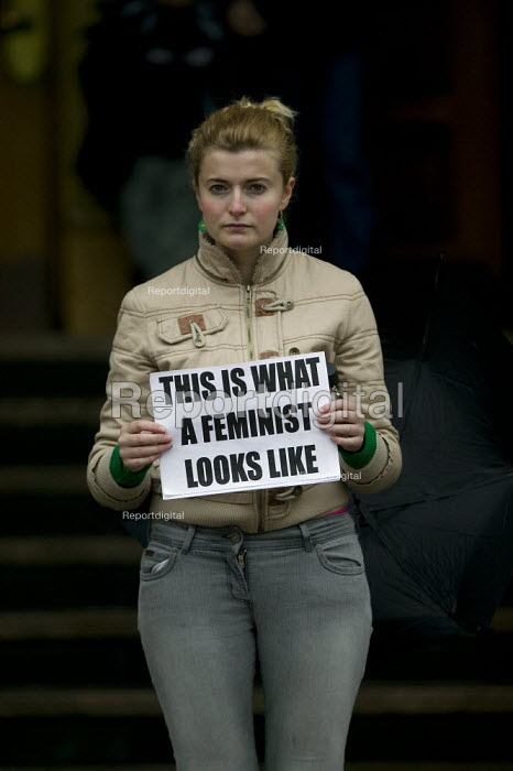 This is what a feminist looks like. Women posing with a placard. - John Harris - 2008-05-17