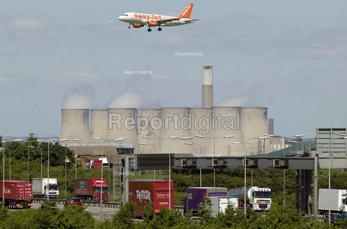An Easyjet passenger jet come into land at East Midlands Airport over the M1 Motorway and Ratcliffe-on-Soar power station. - John Harris - 2008-06-09