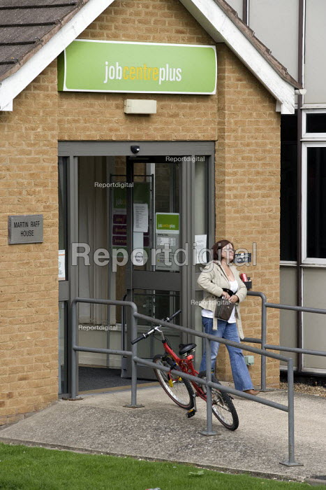 A woman leaves a Job Centreplus. - John Harris - 2008-08-29