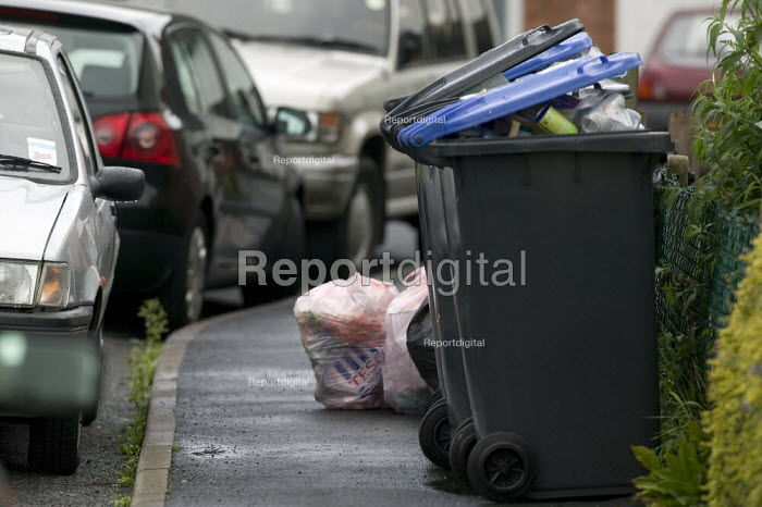Rubbish recycling bins on the street outside a rented house of multiple occupancy. - John Harris - 2008-08-08