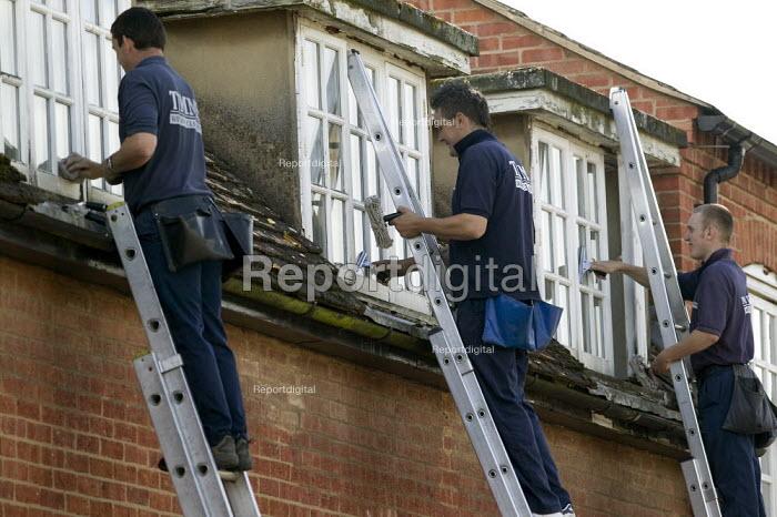 Window cleaners at work cleaning windows. - John Harris - 2008-08-22