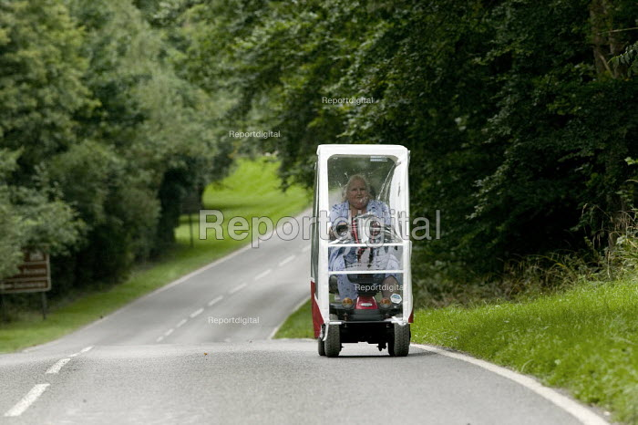 An the elderly woman driving her motorized scooter in the countryside. - John Harris - 2008-08-28