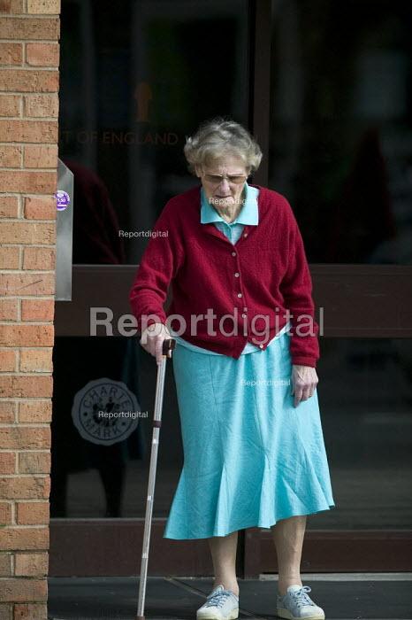 An elderly tenant with a walking stick visiting a housing association. - John Harris - 2008-08-29