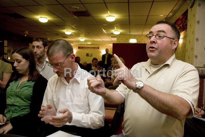 Worried and angry workers meeting to discuss the merger of HBOS and Lloyds TSB, Halifax. - John Harris - 2008-09-25