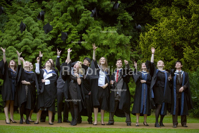 Graduates celebrate their degree passes by the traditional throwing of the mortar boards in the air. Graduation Day, Oxford Brookes University - John Harris - 2008-09-05
