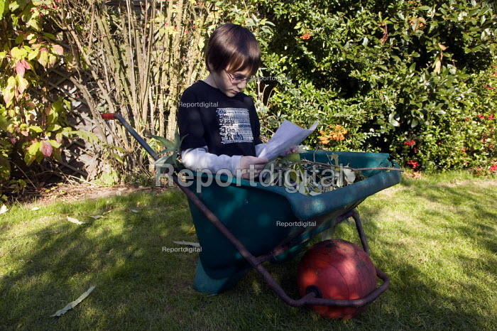 Child revising his times tables in the garden. Stratford on Avon. - John Harris - 2008-10-12