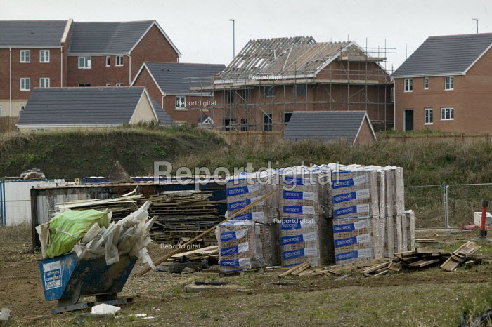 New housing halted, Leeds. Bricks and building materials lie around amoungst unsold anf half built houses, New Forest Village, Oulton, Leeds - John Harris - 2008-10-16