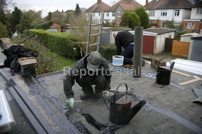 Roofing contractors replacing a flat roof. - John Harris - 2008-12-12