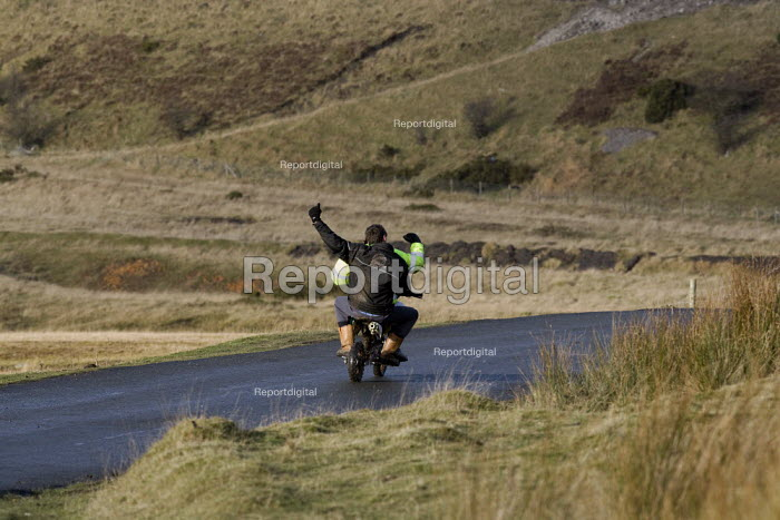 Youth riding a mini motorbike without a helmet, in the hills above Merthyr Tydfil - John Harris - 2008-12-10