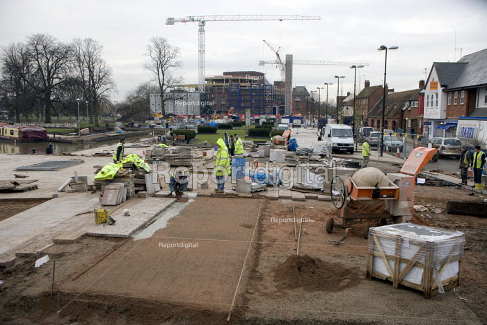 Construction workers working on a new pavement with the RST construction site in the background. Stratford on Avon - John Harris - 2008-12-11