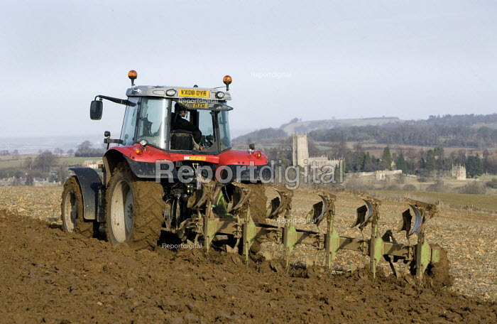 A farmworker ploughing a field on a farm in the Cotswolds. - John Harris - 2009-01-21