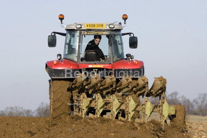 A farmworker ploughing a field on a farm in the Cotswolds. - John Harris - 2009-01-21