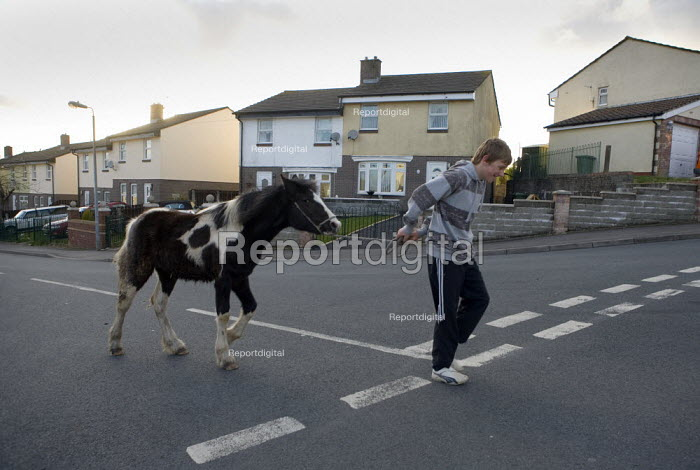 Youth with his pony on a housing estate, Rhymney, South Wales - John Harris - 2009-03-26
