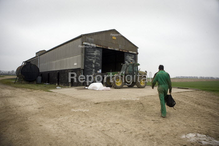 Farmworker arriving to collect a tractor, Lincolnshire - John Harris - 2009-03-18