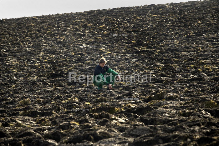 A farmworker checking the drainage prior to sowing crops on a farm in Warwickshire - John Harris - 2009-03-11