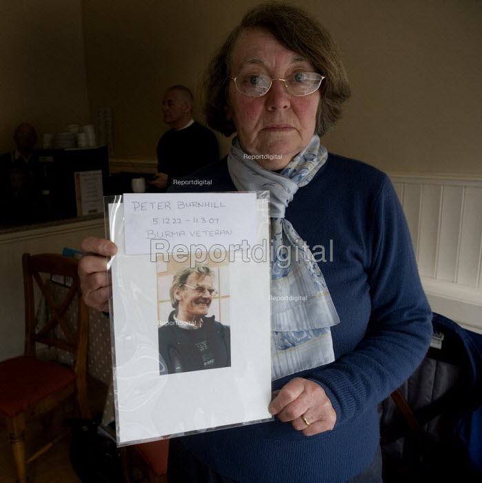 Sonia Burnhill with a picture of her husband Peter who died at Stafford hospital. The campaign group Cure the NHS at their HQ. Hundreds of patients suffered and died unnecessarily as a result of appalling accident & emergency care at the Mid-Staffordshire NHS Foundation Trust according to the Healthcare Commisson in the most damming report ever on a NHS hospital. - John Harris - 2009-03-18