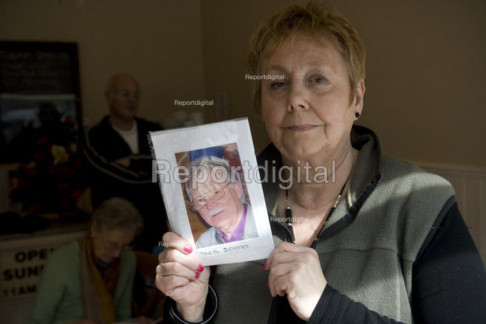 Gillian Peecham with a picture of her husband Arther who died at Stafford hospital. The campaign group Cure the NHS at their HQ in Stafford.. Hundreds of patients suffered and died unnecessarily as a result of appalling accident & emergency care at theMid-Staffordshire NHS Foundation Trust according to the Healthcare Commisson in the most damming report ever on a NHS hospital. - John Harris - 2009-03-18