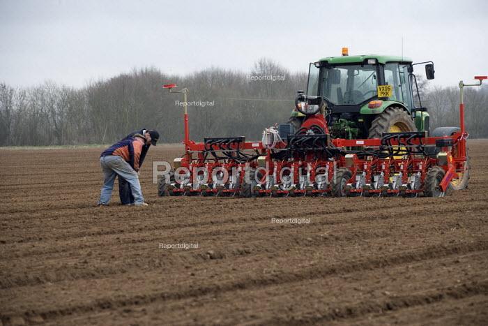 Farmworker using a Precision Pneumatic Seed Drill to sow Leeks. Warwickshire - John Harris - 2009-03-13