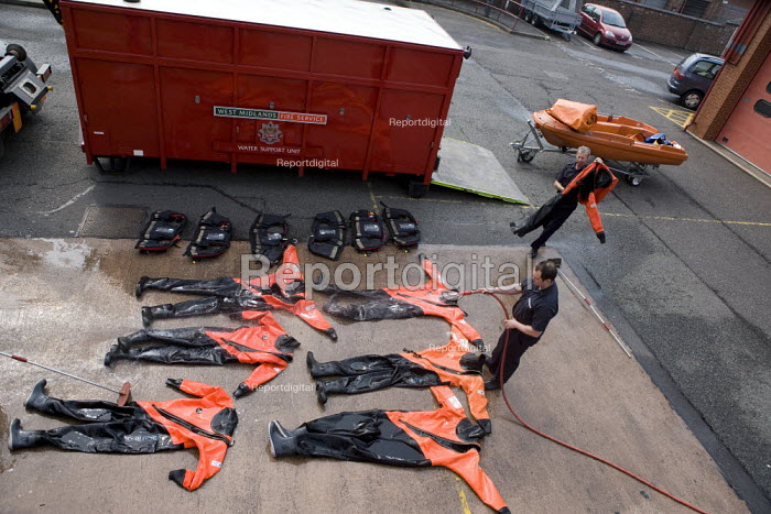 Firefighters cleaning Dry Suits at Perry Barr Fire station Birmingham. - John Harris - 2009-04-17