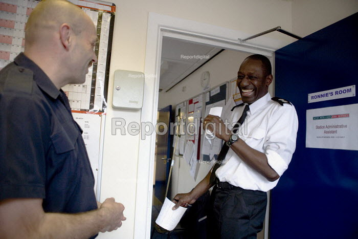 Station commander and firefighter sharing a joke at Perry Barr Fire station Birmingham. - John Harris - 2009-04-17