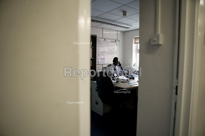 Station commander on the telephone in his office. Perry Barr Fire station Birmingham. - John Harris - 2009-04-17