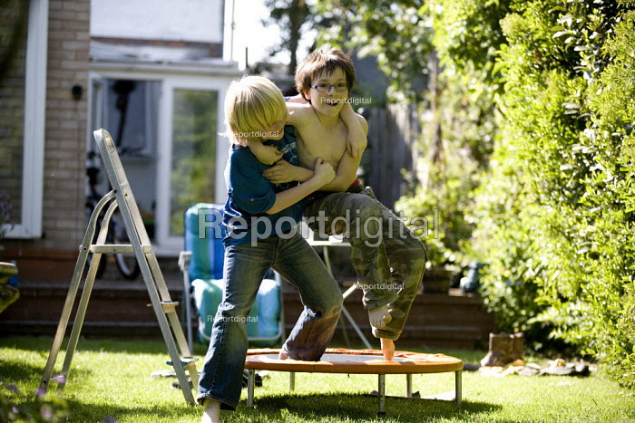 Boys wrestling in the garden. - John Harris - 2009-05-23